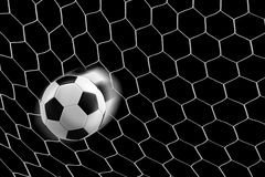 Soccer ball in goal net Royalty Free Stock Photo
