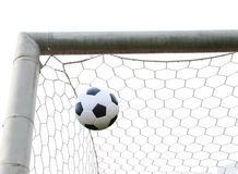 Soccer ball in goal net isolated Stock Photography