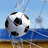 Soccer ball is in goal net Royalty Free Stock Images