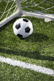 Soccer ball and goal net Stock Photo