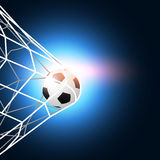 Soccer ball in the goal net Stock Photo