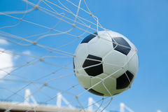 Soccer ball in the goal after shooted Stock Photography