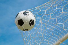 Soccer ball in the goal after shooted Royalty Free Stock Photo