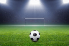 Soccer ball, goal, spotlight Stock Photos