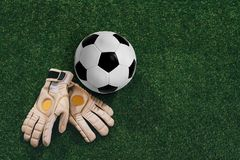 Soccer ball and goalkeeper gloves Stock Photos