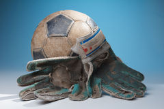 Soccer ball and goalkeepers gloves Stock Photos