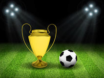 Soccer ball and gold cup in the middle of field. Night football arena illuminated by spotlights. Soccer ball and gold cup in the middle of field. Sports Royalty Free Stock Image