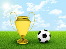 Soccer ball and gold cup in the middle of field Stock Image