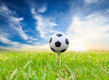 Soccer ball on golf tee Stock Photos