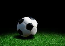 Soccer ball on grass Stock Photos