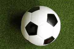 Soccer ball on grass Stock Photo