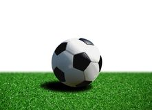 Soccer ball on grass. Over white Royalty Free Stock Photo