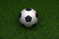 Soccer ball on grass Royalty Free Stock Photos