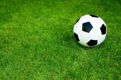 Soccer ball on grass. Soccer ball on the field, high angle view Royalty Free Stock Image
