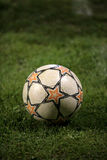 Soccer ball on grass. Closeup of a soccer ball on green grass Stock Photography