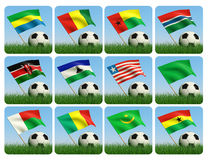 Soccer ball in the grass. African flags. 3d. Soccer ball in the grass and the flag against the blue sky. African flags. 3d Royalty Free Stock Photos