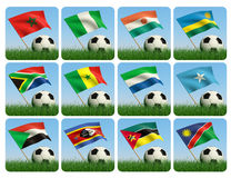 Soccer ball in the grass. African flags. 3d. Soccer ball in the grass and the flag against the blue sky. African flags. 3d Royalty Free Stock Photo