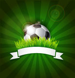 Football Soccer ball in grass with white ribbon Royalty Free Stock Photos