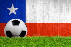 Soccer ball on grass with Chile flag background Royalty Free Stock Image