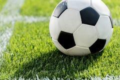 Soccer ball on grass in corner kick position on soccer field stadium Royalty Free Stock Photos