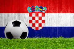 Soccer ball on grass with Croatia flag background Royalty Free Stock Photo