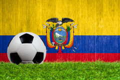 Soccer ball on grass with Ecuador flag background Stock Photography
