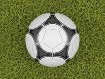 Soccer ball on a grass field background. High quality rendering royalty free illustration