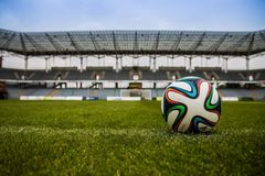 Soccer Ball on Grass Field during Daytime Royalty Free Stock Photos