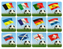 Soccer ball in the grass and the flag. Against the blue sky. European flags. 3d Royalty Free Stock Image