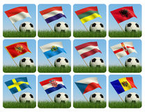 Soccer ball in the grass and the flag. Against the blue sky. European flags. 3d Stock Photography
