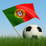 Soccer ball in the grass and flag of Portugal. Soccer ball in the grass and the flag of Portugal against the blue sky. 3d Stock Photo