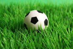 Soccer ball on a grass pitch Stock Image
