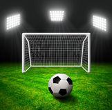 Soccer ball in grass. Soccer stadium with the dright lights Stock Image