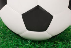 Soccer ball on grass Stock Images