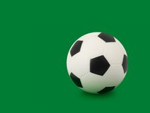 Soccer ball on green. Soccer ball, isolated on green background Royalty Free Stock Photo