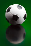 Soccer ball on green background Stock Photography