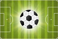 Soccer ball on green background poster design Royalty Free Stock Photos