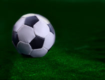 The soccer ball on  green background Stock Photo