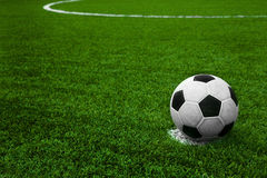 Soccer ball on green field. Soccer ball on soccer field. Space for your text Royalty Free Stock Images