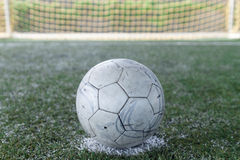 Soccer ball on  green field Stock Photo