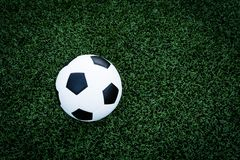 Soccer ball on the green field Royalty Free Stock Photography