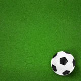 Soccer ball on green field background Royalty Free Stock Photography