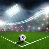 Soccer ball on the green field. Corner stock photography