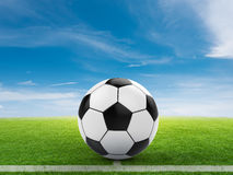 Soccer ball on green field. 3d rendering soccer ball on green field with blue sky Stock Photo