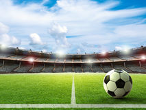 Soccer ball on green field. 3d rendering soccer ball on green field with blue sky Stock Photos