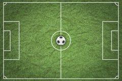 Soccer ball on green field. Stock Photos