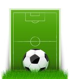 Soccer ball on the green field with grass. Vector illustration Stock Image