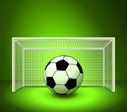 Soccer ball on the green field Royalty Free Stock Photo