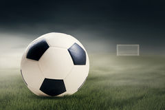 Soccer ball on the green field Stock Images