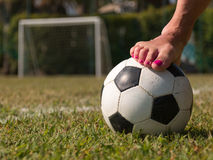 Soccer ball in a green field near a five-a-side goal, outdoor Royalty Free Stock Photography
